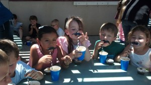 Mustache children with cups straws